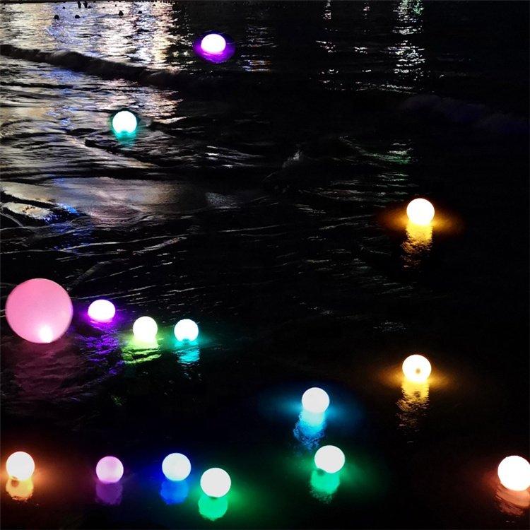 LED orb lights floating on sea